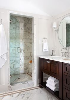 Chalet Development    Gorgeous ensuite with gray walls, walnut stain double bathroom vanity with calcutta gold marble countertops,,,' more of that beautiful space