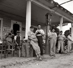 "Fourth of July 1939 near Chapel Hill, North Carolina. ""Rural filling stations become community centers and general loafing grounds. Cedargrove Team members about to play in a baseball game.""  by Dorothea Lange"