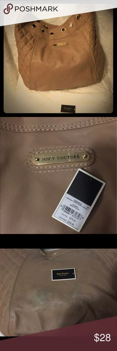 Juicy Couture Handbag Preowned Juicy Couture handbag.  Overall great condition but some fading on the backside of the bag as shown in picture. Juicy Couture Bags Shoulder Bags