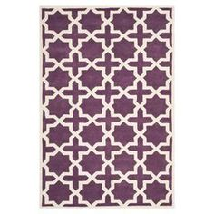 Hand-tufted wool rug with a trellis motif in purple and ivory.   Product: RugConstruction Material: 100% WoolColor: Purple and ivoryFeatures:  Made in IndiaHand-tufted  Note: Please be aware that actual colors may vary from those shown on your screen. Accent rugs may also not show the entire pattern that the corresponding area rugs have.Cleaning and Care: Professional cleaning recommended