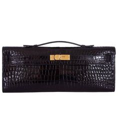 Hermes Kelly Cut Black Porosus Crocodile Kelly Cut Clutch Gold Hardware   From a collection of rare vintage clutches at https://www.1stdibs.com/fashion/handbags-purses-bags/clutches/