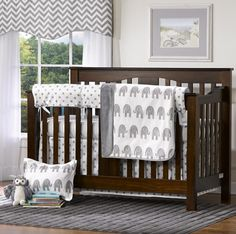 Gray Elephants 4 pc. Crib Bedding Set with Rail Cover – Liz and Roo. Bumper-free baby bedding in adorable marching elephants print. Get the set or mix and match separates from our gray and white chevron to create your own collection. You'll love your Liz and Roo Nursery! American Made Nursery Bedding.
