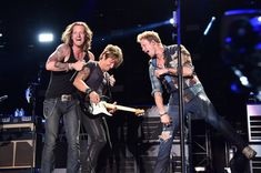 Keith Urban - 2014 CMA Festival - Day 3 still don't like FGL, but I LOVE this pic of Keith