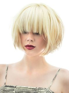 Short bob with bangs. couldn't stand bangs that long, but i like the shape.