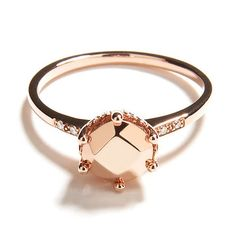 """The Hazeline is a corner stone of the solitaire collection. A classic style with a delicate silhouette, this timeless design is based on a ring that belonged to Anna's grandmother. It is shown here with a solid 14kt rose gold """"gemstone"""" center in an all rose gold setting, with a hidden champagne diamond inside the band.  http://www.annasheffield.com/"""