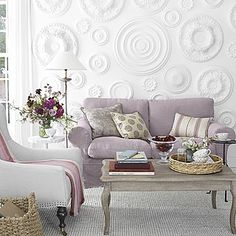 love this white on white idea for a focal wall! love the muted tones of the furniture too..