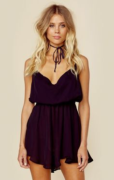 """This silk cocktail dress lends a sexy vibe to a night out. Features a cowl neck, smocked elastic waistband, asymmetrical skirt and spaghetti straps that go around open back and tie at low back.Made in BaliDry clean only100% SilkFit Guide:Model is 5ft 8 inches; Bust: 33"""", Waist: 24"""", Hips: 34""""Model is wearing a size XSMeasures 33"""