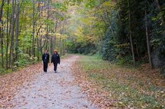 Two hikers stroll along the rail-trail at Ohiopyle State Park, Pennsylvania.