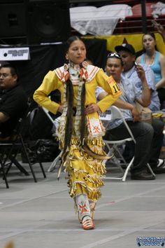 Old Style Teen Jingle Dress at Gathering of Nations Powwow 2011.