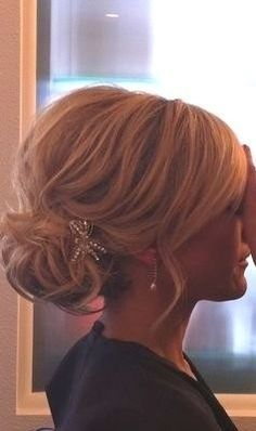 I like this for a bridesmaid hairstyle!!