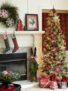 If you're searching for country Christmas mantel decorating ideas, look no further. This rustic scene takes the cake. To get the look, make use of plaid trees, stockings, and snowflakes. A pair of adorned skis next to the fireplace add a whimsical touch. Christmas Fireplace, Christmas Mantels, Christmas Home, Christmas Crafts, Christmas Ideas, Christmas Villages, Father Christmas, Christmas Wreaths, Christmas Ornaments
