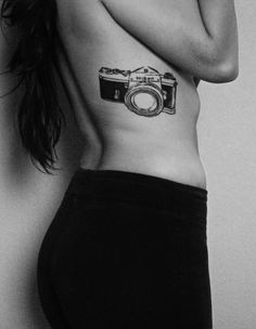 My nikon camera tattoo done by Sodapop at Above All Tattoos in PB