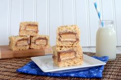 Rice krispie treats are more fun when they have candy bars stuffed in the middle.