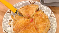 """Sausage and pepper brie in croute 1/4 lb sausage green pepper 1 red pepper 1 small onion S &P 1 11x17"""" sheet frozen prepared puff pastry, defrosted 1 wheel brie cheese, about 5-inches in diameter Preheat oven to 350°F. , cook the sausage until brown. Once brown, remove the sausage but leave in the fat. Add in the peppers, onions and peppers, season with salt and pepper, and cook until tender.  let cool.,,,"""