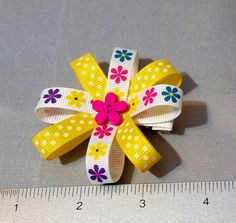 "3.75"" Single Tier Flower Loop Hair Bow - Daisy Print Coordinating Interchangeable Headband Daisy Print and Yellow and White Polka Dot Grosgrain Ribbon Covered and Lined Alligator Clip Perfect hair bow"
