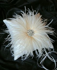 Chic feathered ring pillow from Etsy shop Weddings and Such
