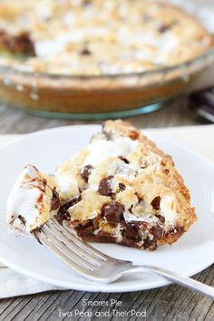Easy S'mores Pie  1 stick Softened Butter ½ cups White Sugar 1 whole Egg 1 teaspoon Vanilla 1 cup Flour 1 cup Graham Cracker Crumbs 1 teaspoon Baking Powder 7 ounces, weight Container Of Marshmallow Creme 8 whole (1.55 Oz Bars) Hershey's Chocolate Bars, Unwrapped 1 cup Marshmallows ¼ cups Chocolate Chips