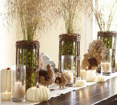 Focus on the tall centerpieces - We could use wheat bundles and fill containers with (what looks to be) grapes... Sukkot or Tu B Shevat