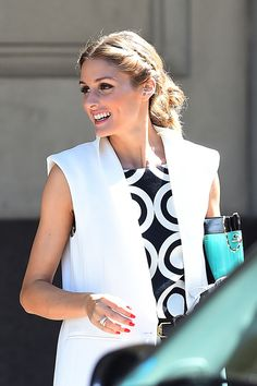 Palermo looks absolutely radiant in a loose, center-parted updo, and her red nail polish is the perfect complement to her monochrome outfit.   - ELLE.com