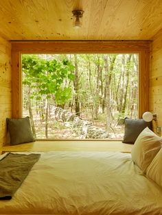 A large picture window provides a beautiful view of the surrounding woods.