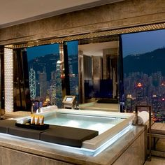 I need this right now!!! Excellent interior, love the combination bath jacuzzi, what a breathtaking view!