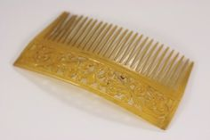 Hey, I found this really awesome Etsy listing at https://www.etsy.com/listing/251577288/art-deco-open-work-antique-hair-comb
