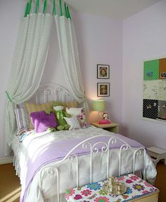 Eclectic girl's room featuring a simple but chic canopy bed