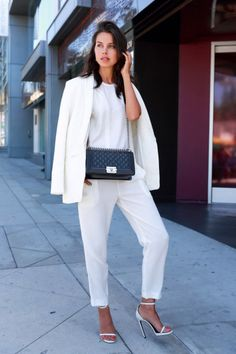 25 Winter White Outfits to Try - white trousers worn with a white top, over-the-shoulder blazer, + black Chanel bag