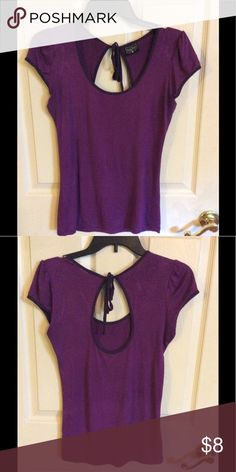 Purple Stretch Top This top has lots of stretch. It is a medium but can easily stretch to fit a larger size. This is extremely light weight. Rock Steady Tops