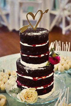 naked chocolate and berry wedding cake