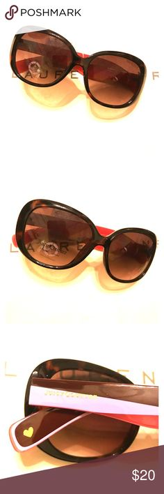 Juicy Couture Sunglasses Cute sunglasses in perfect New condition. Has Pink sides with heart and Logo on each side. Juicy Couture Accessories Sunglasses