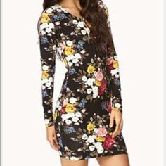 floral bodycon floral stretchy bodycon dress. long sleeved. great for fall with a jacket and knee high boots. purchased at Forever 21, but identical to a bodycon from Urban. *** dress is exact same styleas cover pic, except with a different pic. the actual dress is 2nd pic*** Urban Outfitters Dresses Long Sleeve