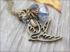 Bluebird Flying Necklace on Antique Brass Chain with by Kitschish, $22.00