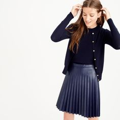 """1 Day SALE! J Crew Faux-Leather Pleated Mini Skirt New with tags and SOLD OUT! J. Crew pleated faux-leather mini skirt in navy color. """"With accordion pleats and a flattering mini length, thus faux-leather skirt looks and feels like the real thing. Poly. Back zip. Dry clean. Import. Item C9160. Size 4. Sits at waist. 18"""" long. Falls above knee. J. Crew Skirts Mini"""