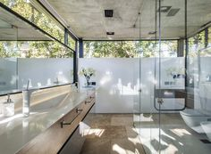 Image 9 of 37 from gallery of BT House / Estudio Jorgelina Tortorici Arq. Photograph by Alejandro Peral Casa Art Deco, Metal Shutters, Raised House, Casa Patio, Concrete Structure, Roof Plan, Ground Floor Plan, Home Upgrades, Architect House