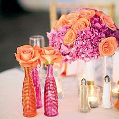 Vibrant Orange and Pink Centerpiece - Wedding Table Centerpieces - Southernliving. Orange roses and pink hydrangeas bring a pop of color to these reception tables. Bud vases with single stems of orange roses add extra pizzazz.