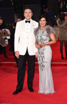 Dapper duo: David Williams andSusanna Reid made for a handsome pair as they took to the spotlight at the Spectre premiere in London