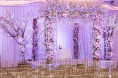 ICYMI: We still can't get enough of this enchanting #chuppah design. At over 10-ft tall, the incredible structure constructed of custom wood, #roses, #orchids, #hydrangea, and #cherryblossoms is a blush #bloom fantasy! See more on WedLuxe.com! | Photography by: Altf Photography | WedLuxe Magazine | #wedding #luxury #weddinginspiration #eventdesign