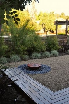 wood bench, gravel edged with low grass and greenery - contemporary landscape by Huettl Landscape Architecture