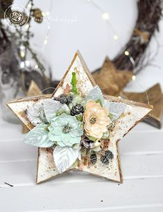 """""""I love the star shape of my wood block! It is a simple, raw base for some extra rich decorations! To decorate, I used Sweet Peppermint paper, Color Bloom Spray mists, and Prima flowers. I love to use Color Bloom sprays to give a watercolor effect to my projects."""" ~ Marta Piekarczyk"""