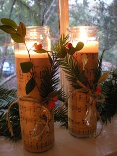 christmas candle with music sheet - print off some sheet music and line glass vases, insert battery operated candle