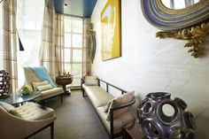 Dineen Architecture + Design  Yellow, blue and purple punch up this otherwise neutral light flooded sitting room.