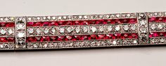 This ruby and diamond bracelet hails from The Art Deco Period (1920-1935), which produced dazzling jewelry that was dramatically different from the jewelry of the previous periods, shifting from soft colors and flowing sinuous lines of the earlier Art Nouveau and Edwardian eras to bolder, brighter colors and straight lines.