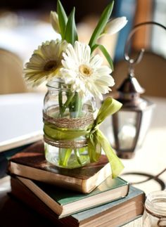 like the book, mason jars, twine and ribbon. Use colored gerbers and maybe ferns or leaves