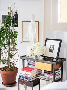 Love how this bedside table provides ample space to hold an ample collection of and photography.