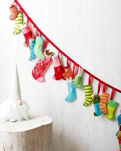 "Mini-Felt-Stockings Advent Calendar: 77"" long, stockings are 4-8"" tall and 1.5-3"" wide. £62.24 | Garnet Hill"