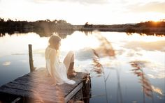 I want to be on a pier on a lake, at dusk, looking beautiful in lovely clothes :D Spell Designs....