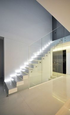 Lights for stairways are as crucial as the lighting of any rooms in your house. A good lighting for the stairs should not be underestimated. The dark stairways might cause a . Modern Stair Railing, Stair Handrail, Modern Stairs, Interior Staircase, Staircase Design, Interior Architecture, Interior Design, Stair Design, Staircase Remodel
