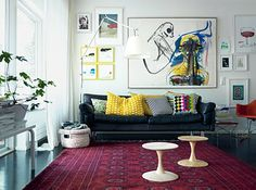 from petra bindel.  white with color.  and black leather couch.