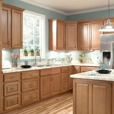 Image result for kitchen honey cabinets quartz countertops